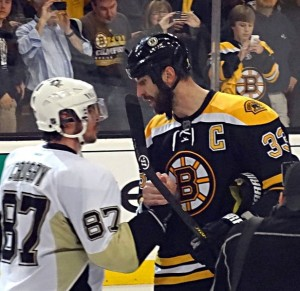 Zdeno Chara and Sidney Crosby shake hands after 2013 Eastern Conference Final. Image Courtesy of Wikipedia Commons.