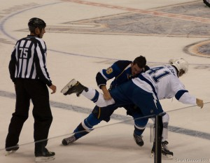 Anthony Peluso and Eric Neilson drop the gloves. Image Courtesy of Wikipedia Commons.
